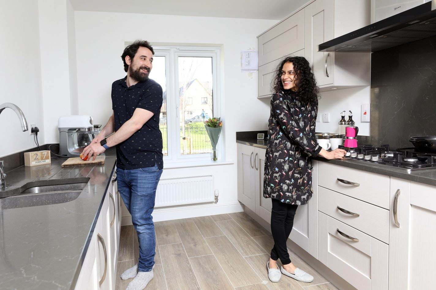 Couple in their kitchen at Wintringham St Neots